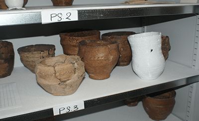 An image of museum specimens (pottery) on shelving