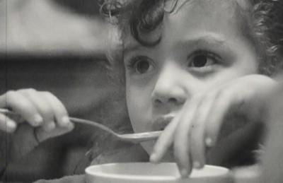 Girl eats soup
