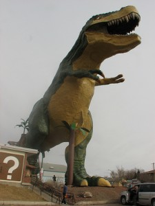A super-sized Tyrannosaurus greets visitors to Drumheller in Alberta, Canada. From Flickr user ceasol.