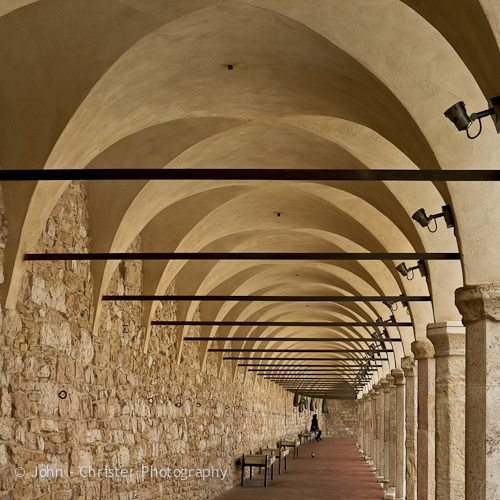 Under the colonade of the lower piazza of the Basilica of St Francis of Assisi