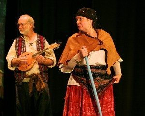 "Bryan Ibach and Corrie Gant, onstage during a performance of ""The Legend of Old Befana"" t the Sawdust Theatre in Coquille, Oregon"