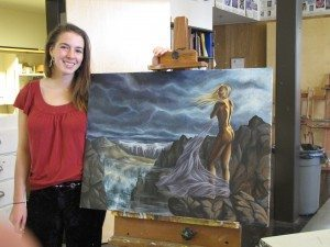 AHS student, Raven Borgilt poses with her painting