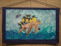Handpainted silk wall hanging with an endangered sea turtle design by Judy Elliott