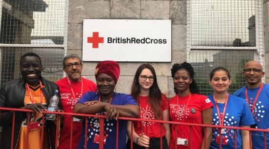 British Red Cross volunteers wearing either red or blue refugee week t-shirts