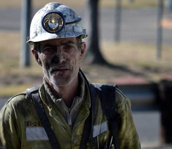 Coal miner with a helmet and headlamp