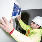 Technician installing heating system