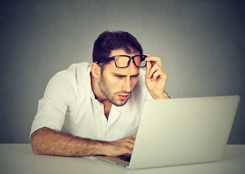 man with glasses at laptop