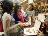 Sales lure us into buying separate designer clothes for taraweeh prayers, others for Eid prayers, and yet others for the family Eid dinner. PHOTO: AFP