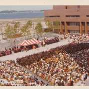 Color aerial photograph of commencement ceremony on UMass Boston's center plaza