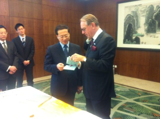 In this photo, UN Deputy Secretary-General Jan Eliasson hands a signed copy of the UN Charter to Mr. Zhijun as a gift to the Ministry.