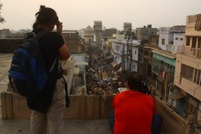 Filming in Vrindavan in a crowded marketplace.