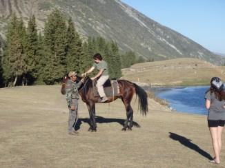 Win riding a Kyrgyz horse in Kyrgyzstan
