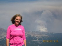 Hilkka Timonen and a distant fire plume seen from Mt. Bachelor, September 2012