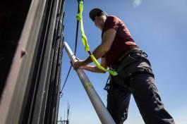 Dan Jaffe installing equipment on top of MBO, July 2019