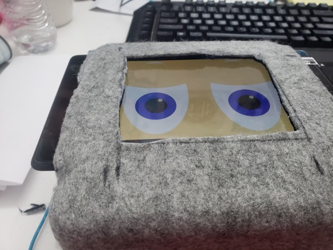 EMAR's face tablet hangs over the edge of the box