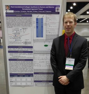 Mikhail Garibov and his poster at AADR annual meeting 2016