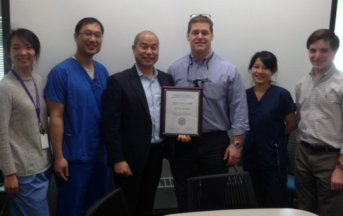 photo of Drs. Jessica Hsu, Alex Ko, Ken Akimoto, Doug Dixon, Vinny Chiu and Andrew Brodsky (l to r), gathered to present Dr. Akimoto with his 2016 Director's Award.