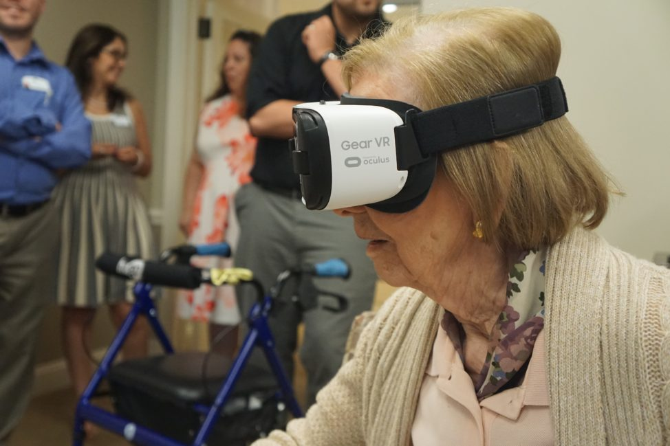 One of Maplewood's residents uses a Rendever VR headset to experience virtual reality in a group session. (Maplewood Senior Living)