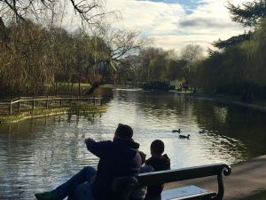 My husband and children relax and take in the views of the lake at Rowntree Park.