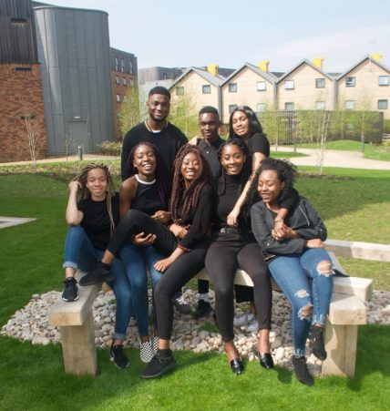 Photograph of Naomi and her friends from the African Caribbean Society.