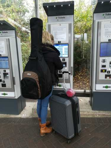 Me buying a train ticket up to York with far too much luggage for one person to carry. Moving from London to York for University.