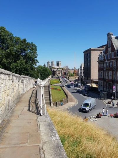 A PICTURE OF YORK DURING A WALK ON THE CITY WALLS ON A SUNNY DAY IN THE SUMMER.