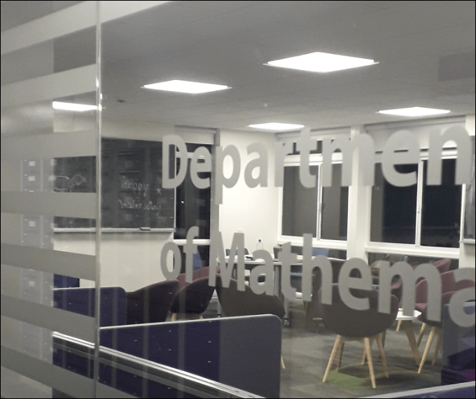 Study space with chairs and a blackboard. Sign on door says 'Department of Mathematics'.