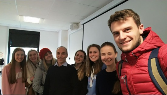 A Language and Linguistic Science seminar group with their module tutor