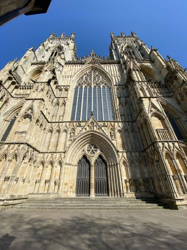 Image of York Minster showing the West Window and bell towers.