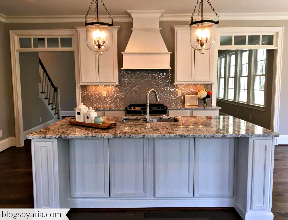 white kitchen pendant lights glitzy back splash granite counter tops