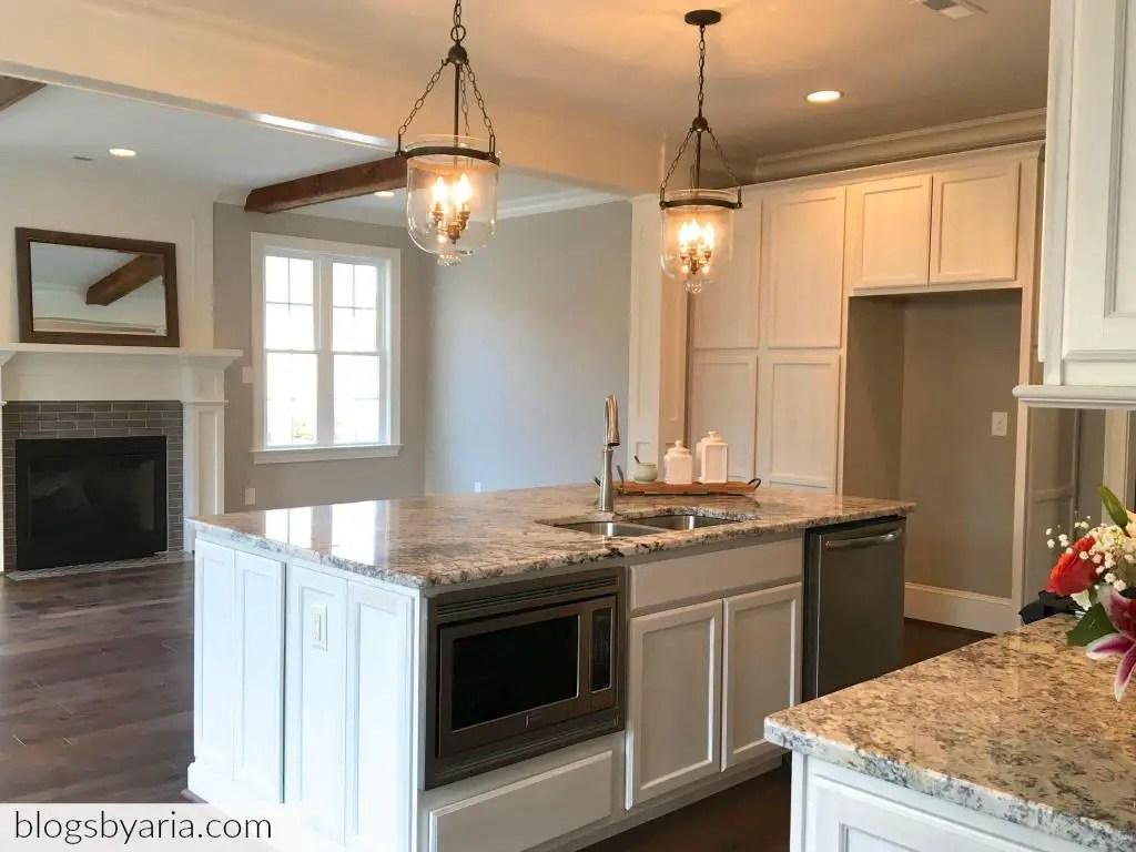 white kitchen granite counter tops pendant lighting microwave drawer