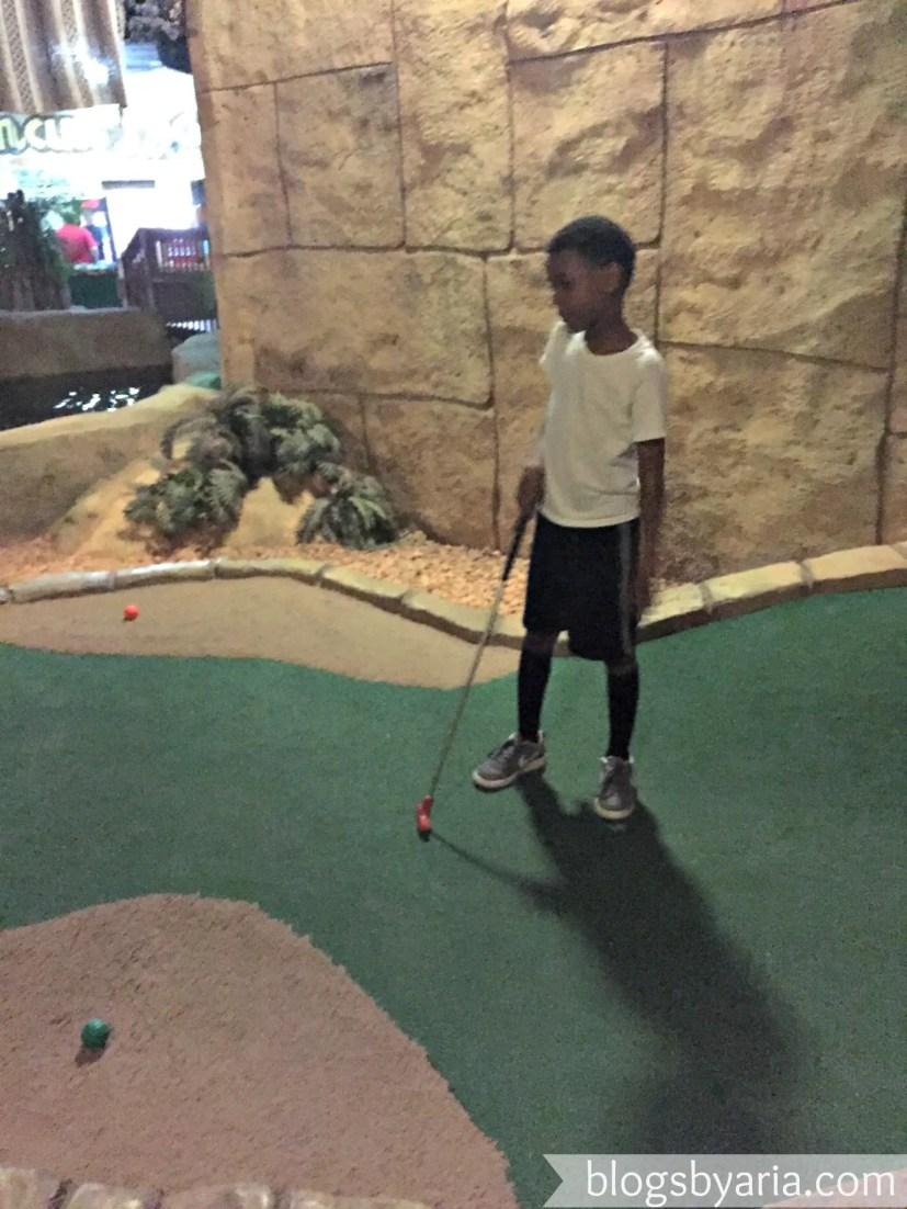 playing miniature golf