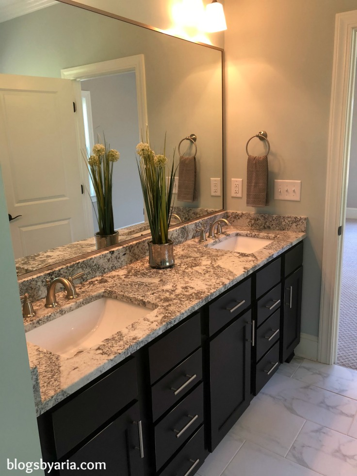 master bathroom with marble-look tile floors