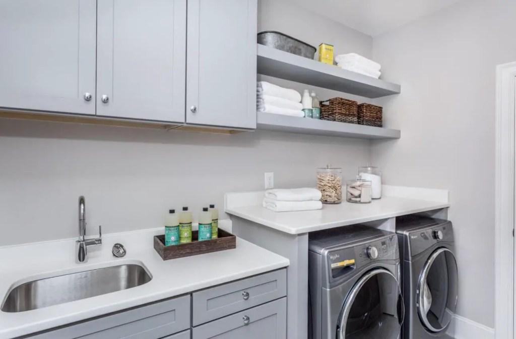 gray laundry room open shelving