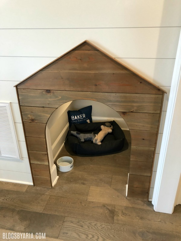 built-in doghouse under stairs