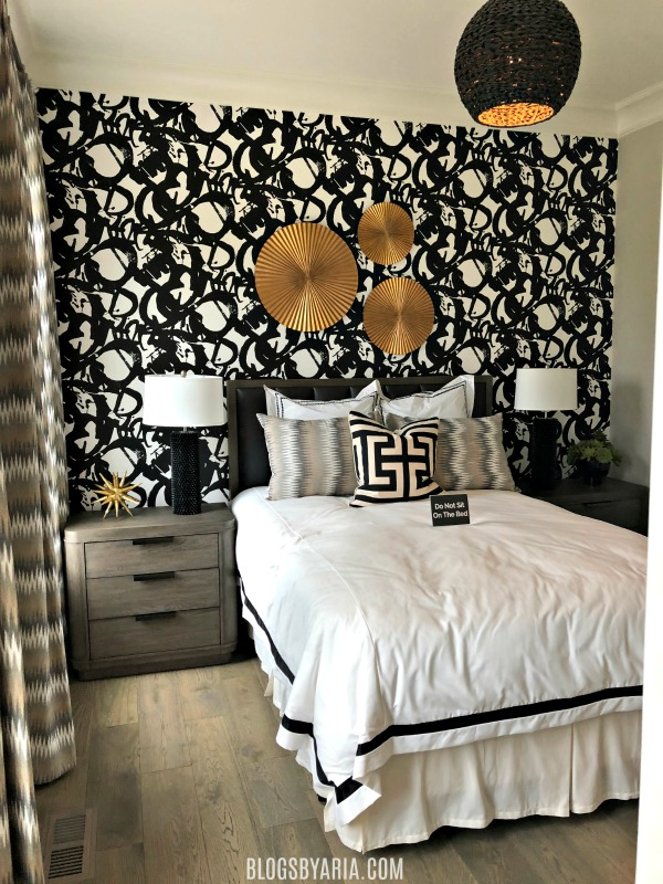 fancy bedroom with wallpaper feature wall