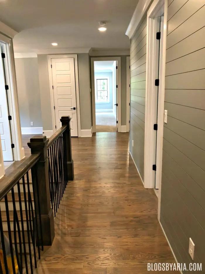 gray painted shiplap hallway