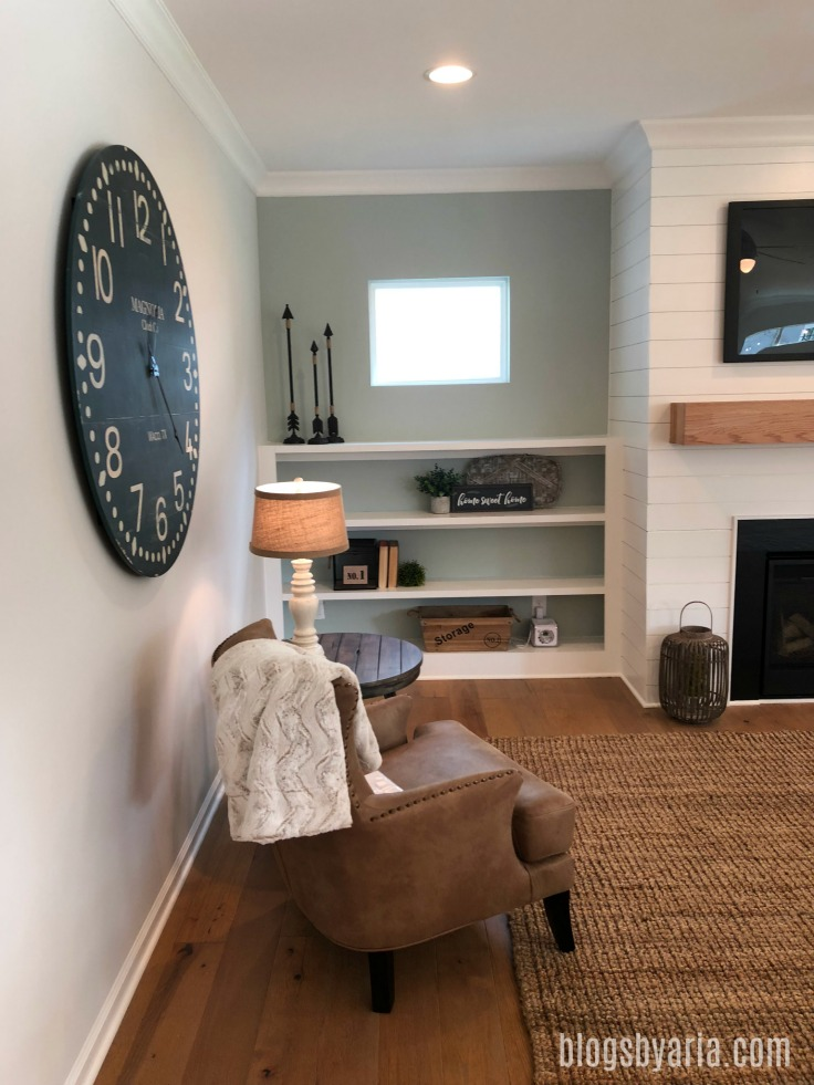 shiplap fireplace with built-in shelving