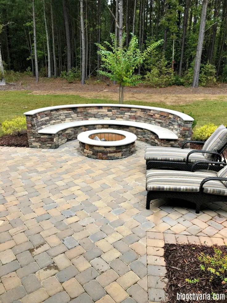 built in stone fire pit backyard