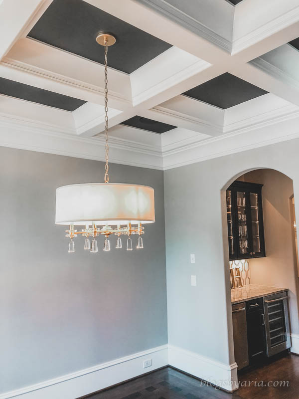 love the paint colors and the coffered ceiling with a peak into the butlers pantry