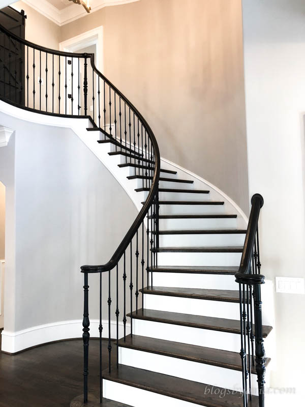 love the curved staircase such a statement