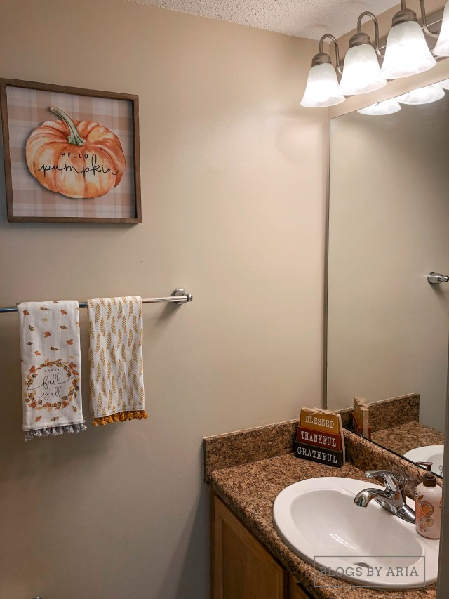 fall decorated guest bathroom