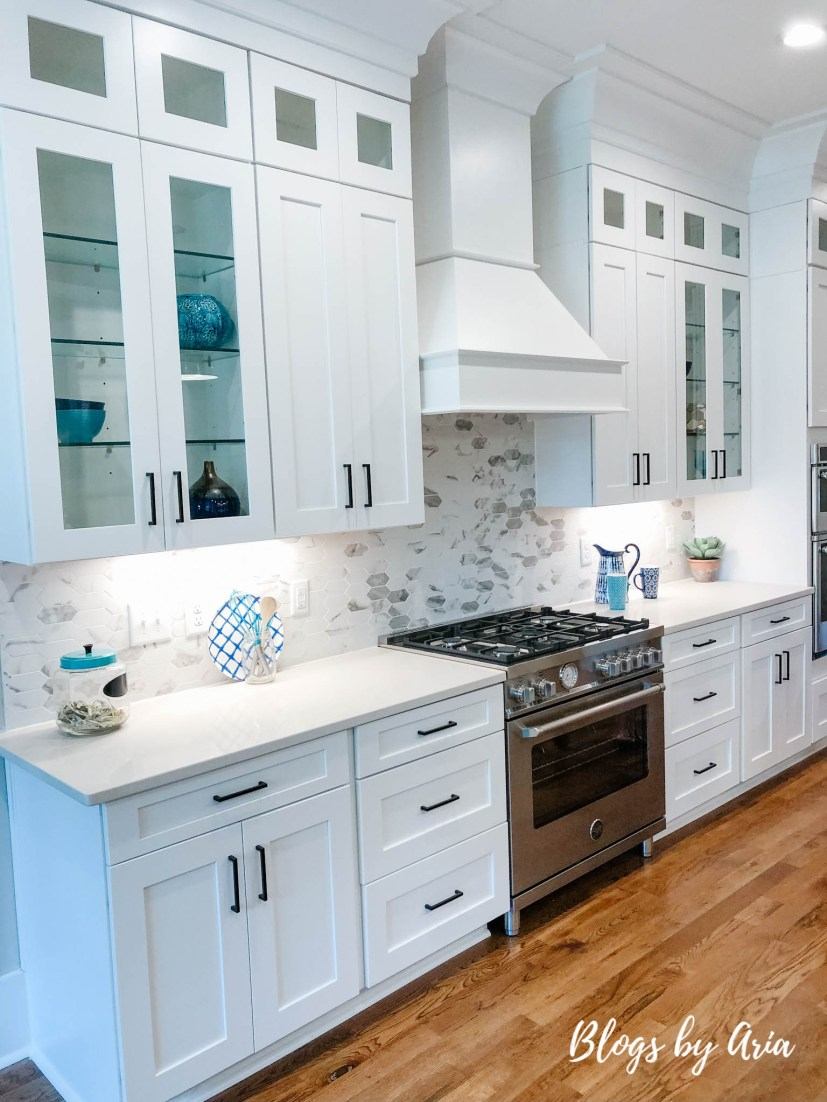 white kitchen with glass shelves for display