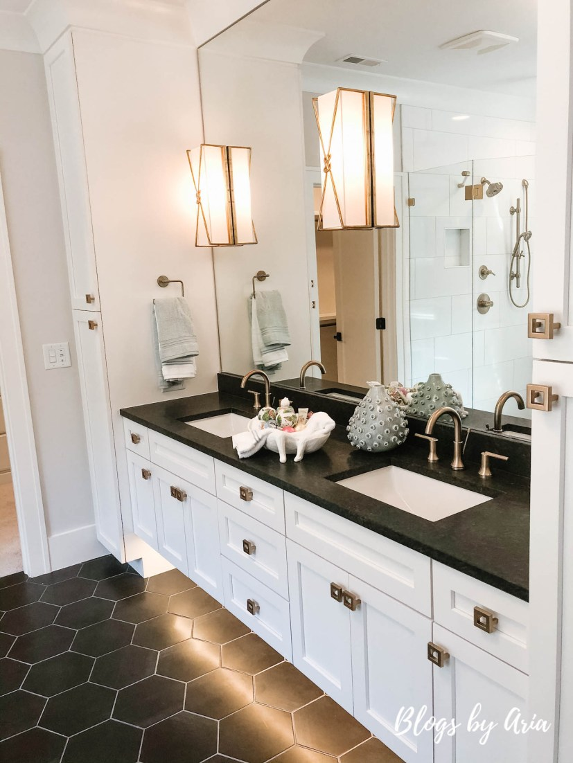 modern glam farmhouse bathroom with gold fixtures