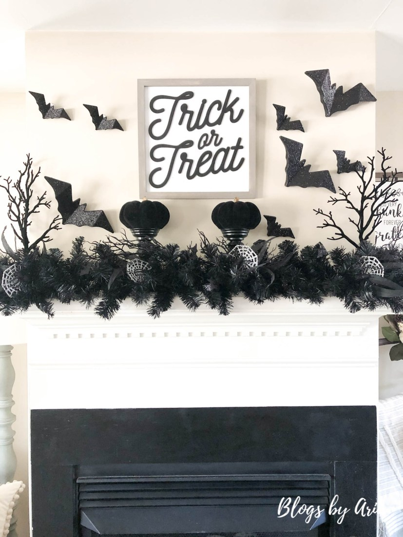 black and silver Halloween mantel