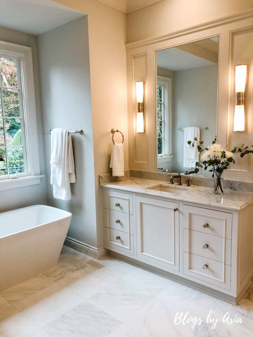 classic master bathroom with floor and wall marble tile