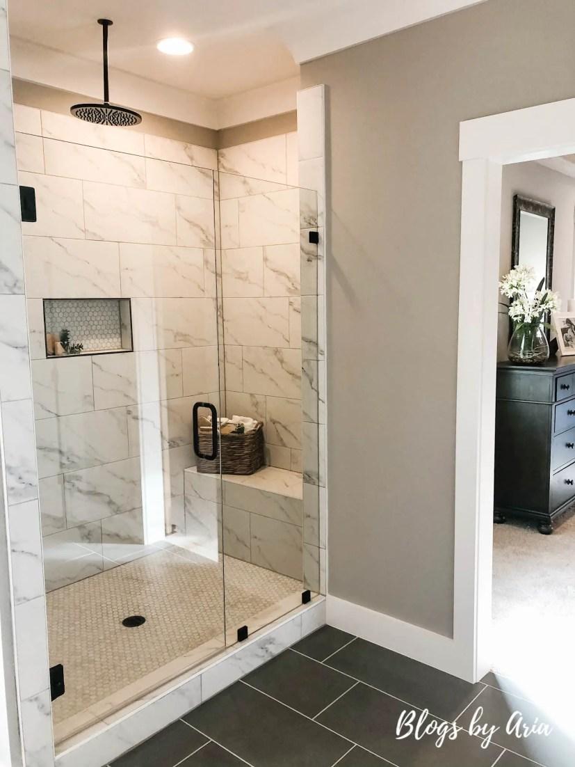 glam modern farmhouse bathroom with black fixtures