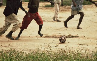 Boys playing football.