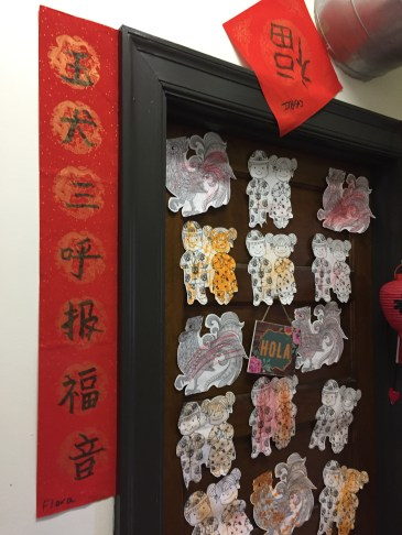 Traditional Spring couplets adorned school doorways.