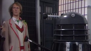 The Doctor (Peter Davison) and a Dalek -Doctor Who - Resurrection of the Daleks